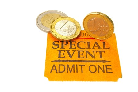 event ticket stub with Euro coins Фото со стока