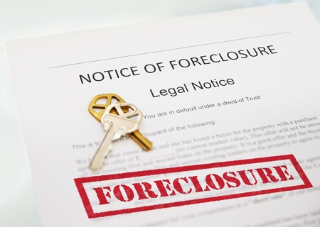 homeownership: Notice of Foreclosure document and house key