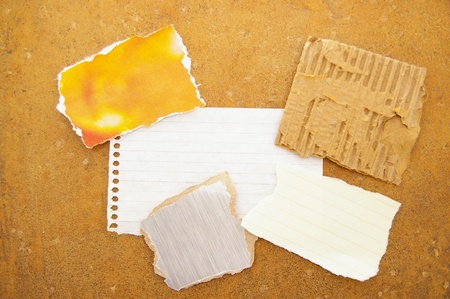 assorted pieces of ripped scrap paper, on grunge background 스톡 콘텐츠