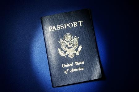credentials: United States passport on blue background Stock Photo
