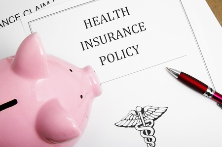 policies: health insurance policy and piggy bank