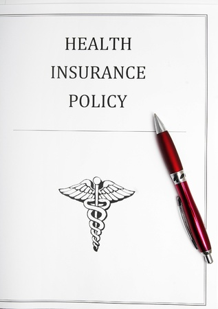 health insurance policy with pen