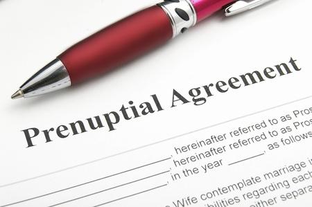 contractual: closeup of a marriage prenuptial agreement