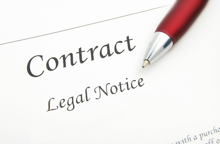 contractual: closeup of a legal contract and pen