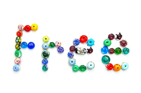 glass bead text spelling Free, on white Reklamní fotografie