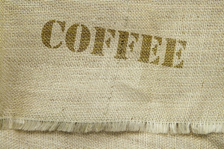 fabric texture: coffee text on a burlap textured fabric