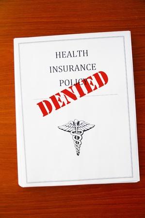 refused: una p�liza de seguro de salud, con  Foto de archivo