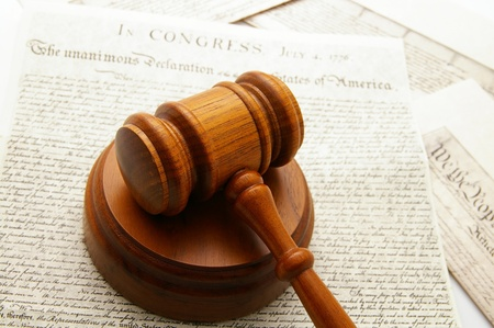 ruling: legal gavel with Declaration of Independence and Constitution documents