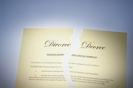 decree: divorce decree document ripped in two