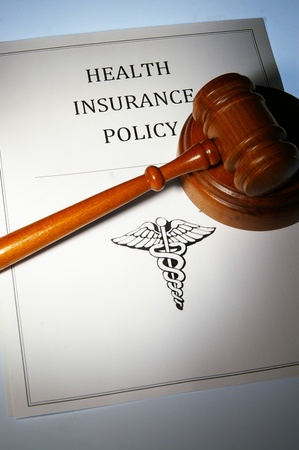 policy document: health insurance policy and law gavel