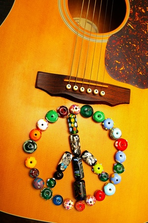 Acoustic guitar and glass beads peace symbol photo