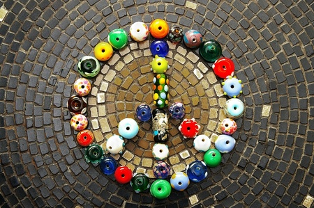 colorful beads: colorful glass beads peace sign on mosaic tiles