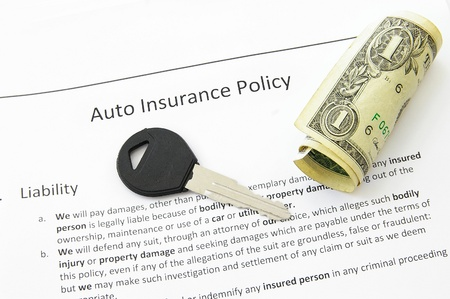 insurance policy: auto insurance policy and car key with money