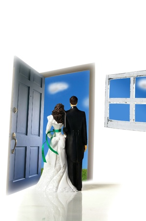 topper: plastic cake-topper wedding couple looking out a door