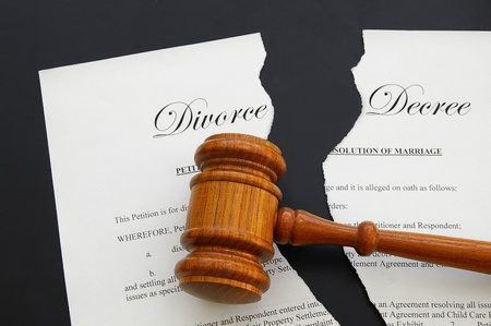 divorce court: torn divorce decree and legal gavel (gavel is sharp)