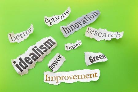 idealism: positive themed newspaper headlines on green