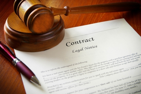 business law: legal gavel and a business contract Stock Photo
