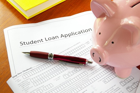 student loan application and piggy bank photo