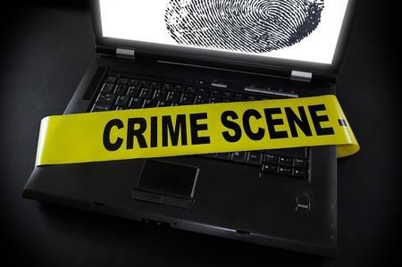 laptop fingerprint with crime scene tape across it Stock Photo - 9523147