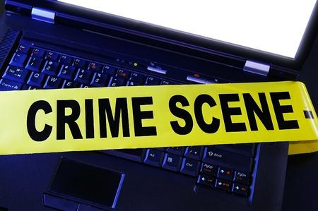 breakin: laptop with yellow crime scene tape across it