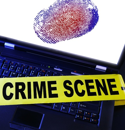 crime: laptop fingerprint with yellow crime scene tape across it Stock Photo