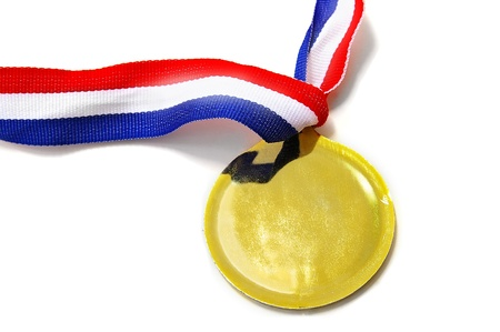 a blank gold medal with ribbon, on white
