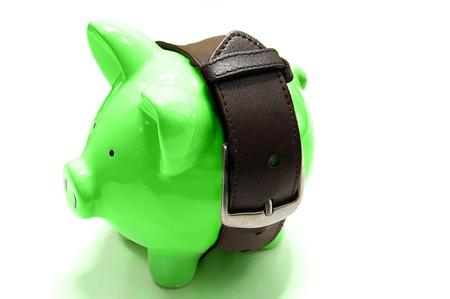 꽉 벨트 - 저축 돈 개념을 가진 돼지 저금통
