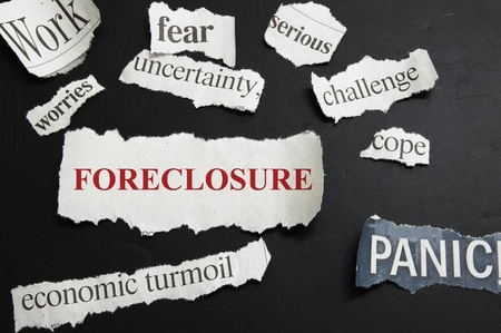 foreclose: Newspaper headlines showing Foreclosure and bad economic news