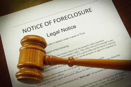 foreclose: Home Foreclosure document and legal gavel