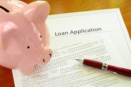 loans: Blank loan application form with piggy bank