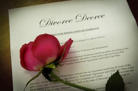 decree: Divorce Decree document with wilted red rose