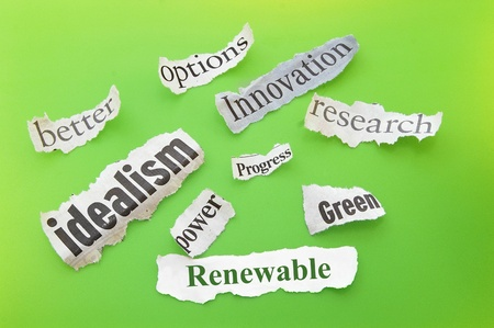 idealism: Renewable themed newspaper headlines on green Stock Photo
