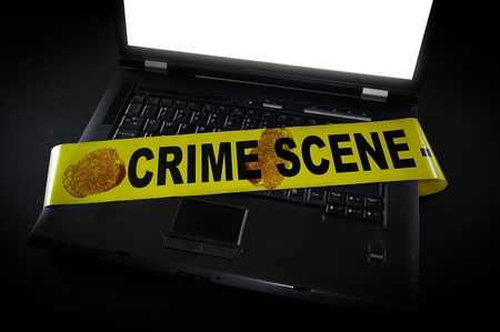criminals: laptop with crime scene tape across it and fingerprints