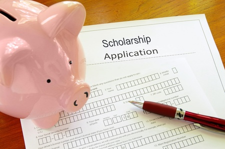 university application: Blank scholarship application form with piggy bank