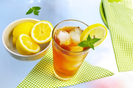 iced tea: cold glass of iced tea with lemon and mint