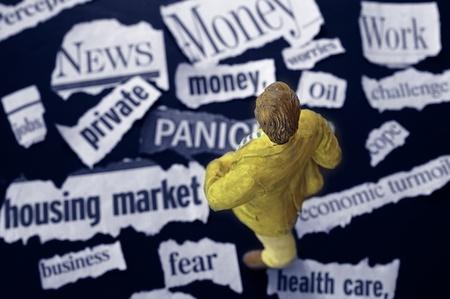 business man figure standing on newspaper headlines photo
