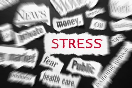 newspaper headlines showing bad news, stress in red photo