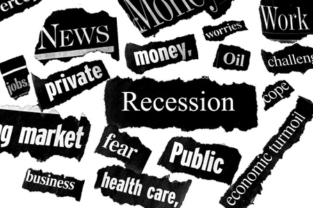 newspaper headlines showing bad news, recession related photo