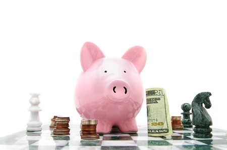 piggy bank on a chess board with money photo
