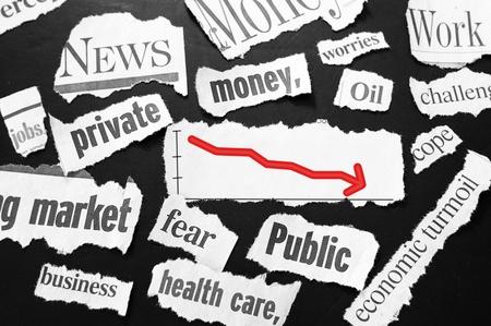 newspaper headlines showing bad news, red down arrow photo