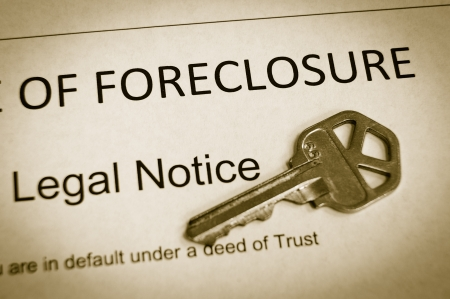 Foreclosure legal notice and house key macro photo