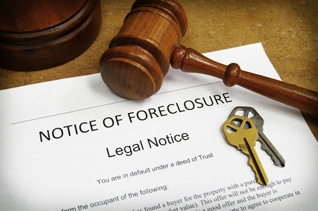 foreclose: Foreclosure document with house keys and gavel