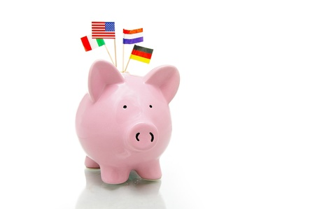 US and European flags and piggy bank on white Фото со стока