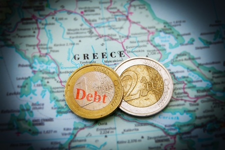 greek coins: Euro coins on a map of Greece (Greek financial crisis)
