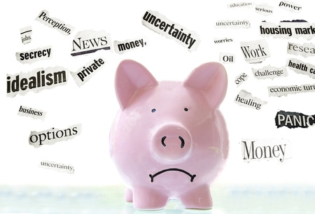 frowning pink piggy bank with bad economic news headlines Banco de Imagens