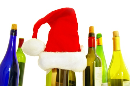 x mas: assorted wine bottles and a santa hat, on white