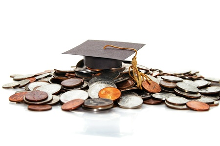 graduation cap  on a pile of money ( student debt ) Stock Photo - 11267113