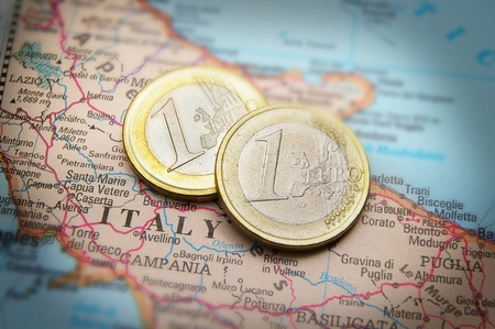europeans: Closeup of Italy on a map and Euro coins Stock Photo