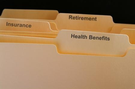 Employee benefits folders, health insurance etc Stock Photo