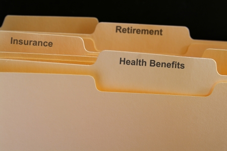 compensation: Employee benefits folders, health insurance etc Stock Photo